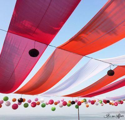 Photo of outdoor red pink and white drapes