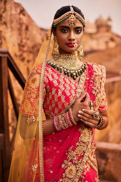 Photo of Dusky Bride in Bright Pink Lehenga and Contrasting Set