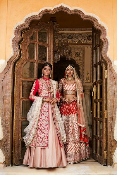 Photo of Deep Red and Dull Gold Bridal Lehenga