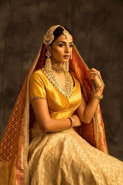 Photo of Gold Bridal Jewellery with Pearl Jhoomer and Satlada