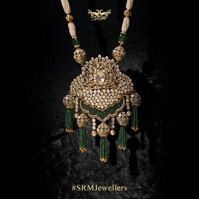 Photo of Polki unique gold necklace pendant with emerald stones