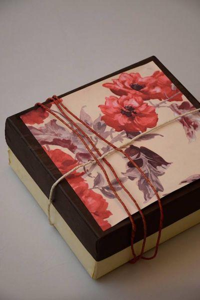 Photo of rustic wooden invitation box with floral print watercolor invite