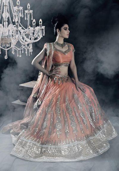Photo of orange peach bridal lehenga with ambi