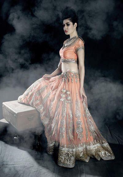 Photo of orange peach bridal lehenga with gold gota work