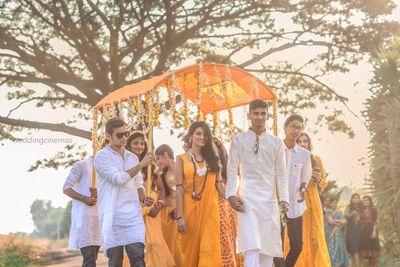 Photo of Bride entering under orange phoolon ki chadar