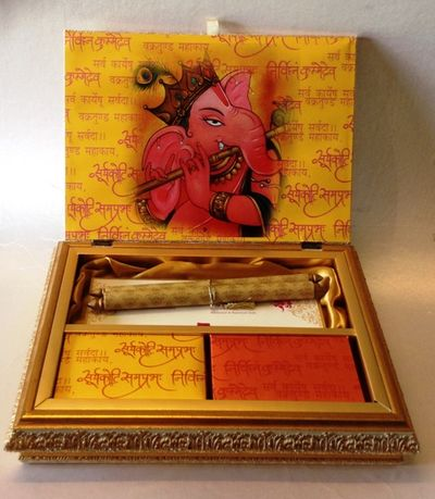 Photo of yellow and red invitation box