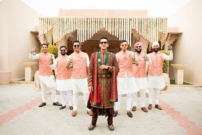 Photo of Offbeat groom sherwani with groomsmen