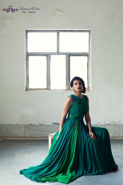 Photo of deep emerald green floor length chiffon gown