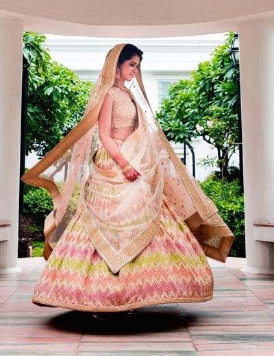 Photo of Off white light bridal lehenga with chevron design