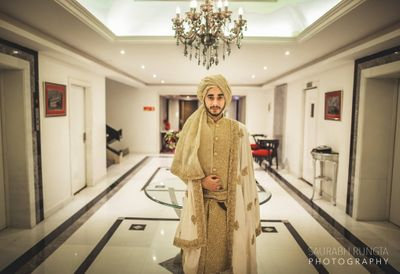 Photo of Gold Glitter Sherwani with Cream Dupatta and Gold Safa
