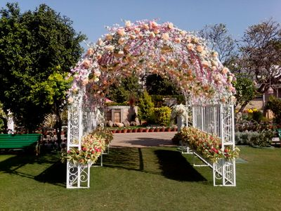 Photo of morning wedding pastel elegant entrance way decor