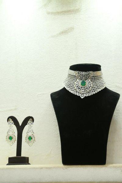 Photo of Diamond choker engagement collar with emerald centerpiece
