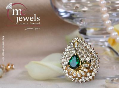 Photo of Diamond and emerald pear shaped cocktail ring