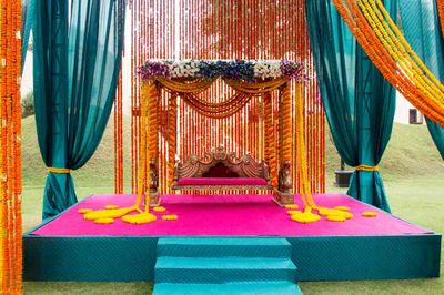 Photo of blue and yellow and pink colorful mehendi decor