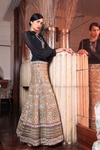Photo of navy blue full sleeves with gold embellished lehenga