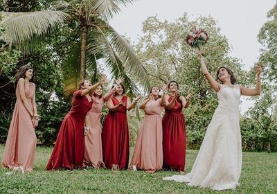 Photo of Bridesmaids catching the tossed bridal bouquet.