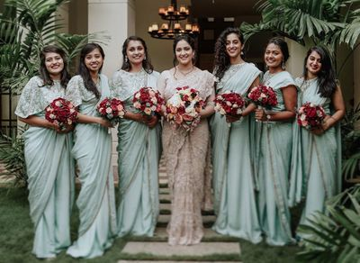 Photo of bride with bridesmaids in matching sarees