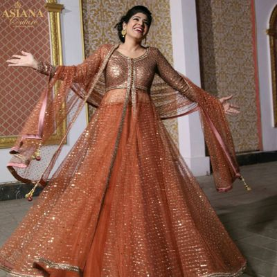 Photo of bronze jacket layered anarkali lehenga with front slit