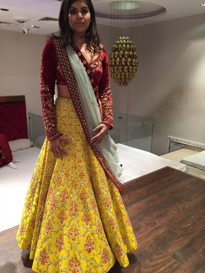 Photo of yellow and maroon bridal lehenga