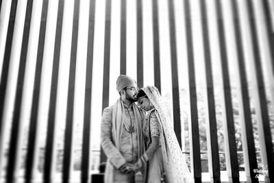Photo of romantic wedding day couple shot in black and white