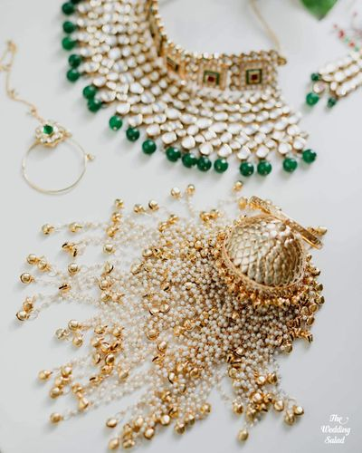 Photo of bridal jewellery photography with gold kaleere