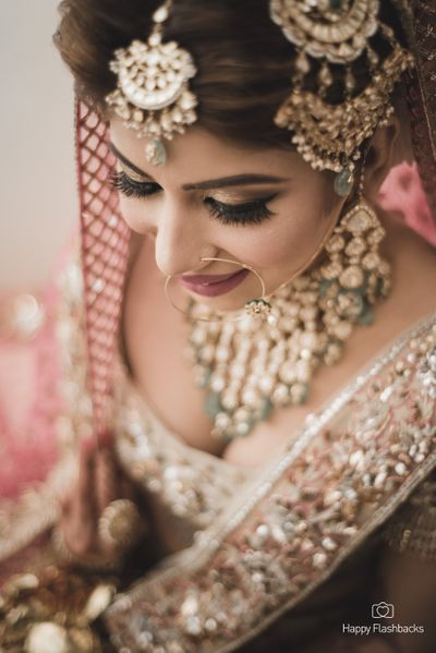 Photo of Top angle bridal portrait wearing loads of jewellery