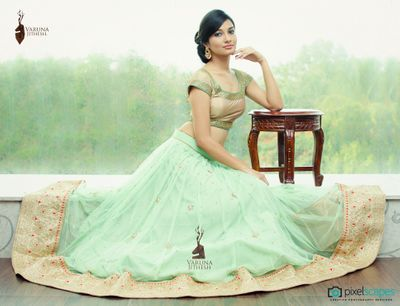 Photo of mint georgette lehenga with border and gold metallic short sleeved blouse