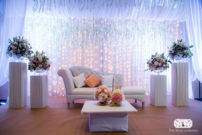 Photo of Pastel sofa decor for engagement with fairy lights
