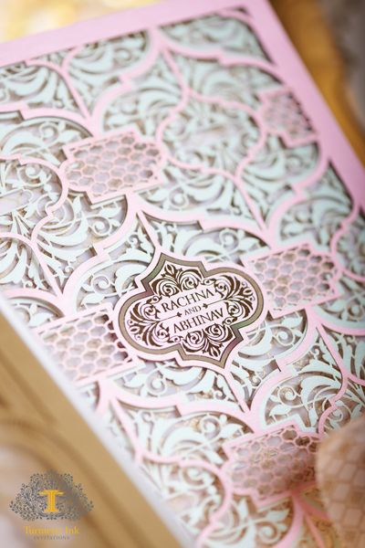 Photo of Light pink and mint laser cut wedding card