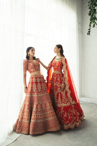 Photo of Stunning bridal lehengas in traditional shades of red