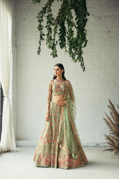 Photo of Pretty green lehenga with detailed threadwork