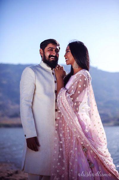 Photo of Romantic couple portrait in colour coordinate outfits