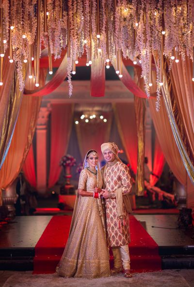 Photo of Red and gold theme couple wedding portrait