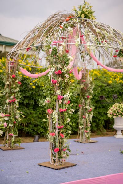 Photo of White Mandap with White and Pink Floral Decor