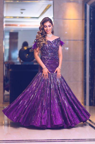 Photo of Purple mermaid gown with tassel sleeves