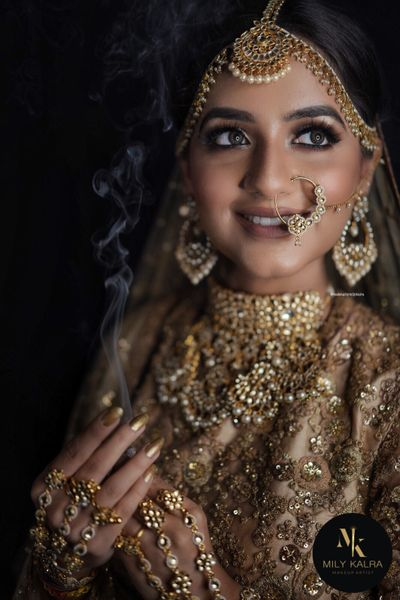 Photo of Nude bridal makeup with beige lehenga
