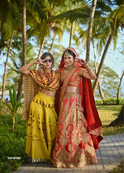 Photo of Bride with sister on wedding day