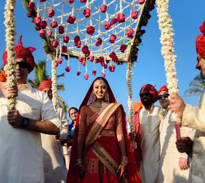 Photo of bride entering under phoolon ki chadar