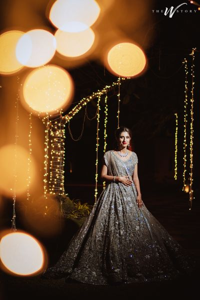Photo of Bride dressed in a glimmering silver lehenga.