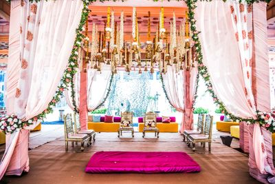 Photo of Mandap in pink with floral printed drapes