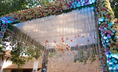 Photo of Mandap decor idea with hanging floral strings