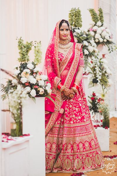 Photo of Red and gold Sabyasachi bridal lehenga on bride