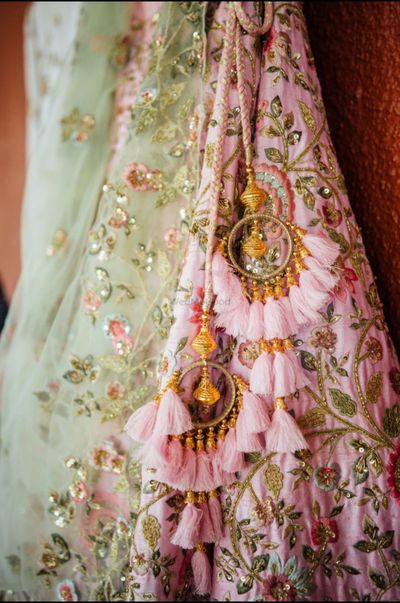 Photo of Pretty pink andgold bridal latkans for an Indian wedding