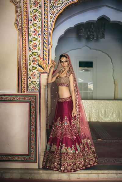 Photo of Wine coloured bridal lehenga with unique Baraat embroidery
