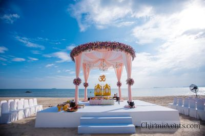 Photo of Pastel floral pink mandap on the beach