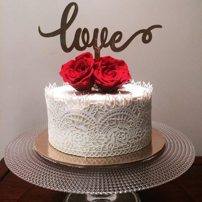 Photo of White Lace Trim Wedding Cake with Roses and Love Topper
