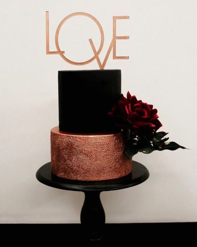 Photo of Unique black and gold 2 tier cake with love cake topper