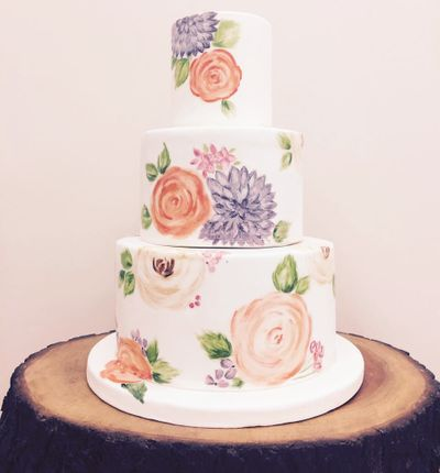 Photo of 3 tier floral print wedding cake with pastel flowers