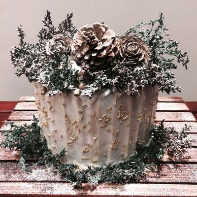 Photo of Unique wedding cake in silver and white with dry twig look