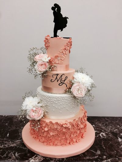 Photo of Light peach pastel cake with romantic cake topper